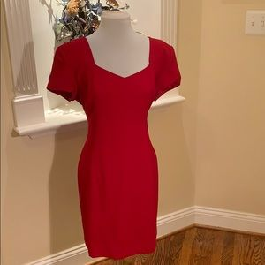 Beautiful red dress! Slightly fitted -flattering